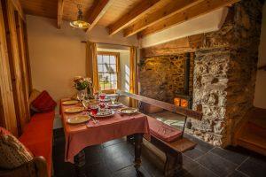 Y Garn Garn Isaf Pembrokeshire B&B Dining Room table with evening meal.jpg